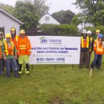 Civil Engineering Technician students survey a Habitat for Humanity build site with a local contractor.